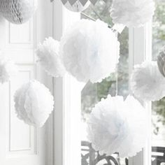Pack of 5 White Pom Poms from http://www.aweddinglessordinary.co.uk/shopexd.asp?id=4707