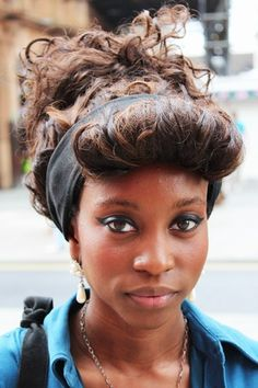 Hair teased roughly up and out and twisted into a loose knot gives a rock star glam finish. Add a bit of a quiff to go the full Amy Winehouse trend.