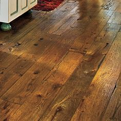 12 Smart Salvage Ideas | Vintage Floorboards | SouthernLiving.com  Install vintage floorboards to give your home instant warmth and age. The Pursells' kitchen and living room floors are comprised of 1-inch-thick oak planks in random widths. Using salvaged wood for flooring is also an eco-friendly choice.