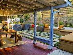 Outdoor Dining Room Offers Shade and Seating. -- This eclectic outdoor dining spot is covered in shade. A pretty tile walkway leads to comfy bench seating surrounded by colorful flowers. Small Outdoor Spaces, Outdoor Rooms, Outdoor Dining, Outdoor Decor, Outdoor Furniture, Patio Design, Garden Design, Spanish Patio, Interior Design Pictures