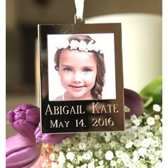 "The photo frame features the name of the communicant and the date, while the reverse is engraved with a chalice and the words, ""My First Holy Communion."""