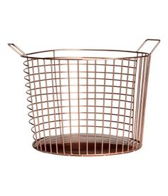 Copper-colored. Large, round metal wire basket with two handles at top. Height 8 in., diameter 11 in.