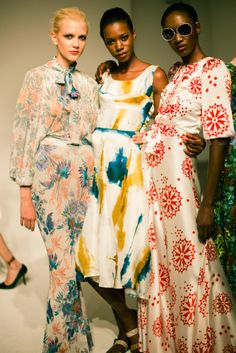 Dress in the middle and on the right. Love the print