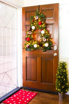 You can easily create a Christmas tree shaped wreath for your front door! Click through for the tutorial! by Sarah Hearts