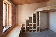 Kids room built in loft and shelves.