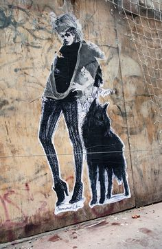 This picture is sick, I want a dark wolf companion... @monsieurqui #streetart
