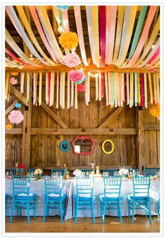 BLUE CHAIRS lovely colorful wedding reception decor with teal, yellow, red, green, pink and blue streamers hung over rafters Prom Decor, Wedding Reception Decorations, Homecoming Decorations, Decor Wedding, Wedding Receptions, Reception Ideas, Deco Champetre, Barn Parties, Summer Parties