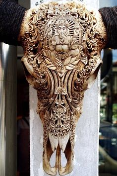 Carved bone - water buffalo skull.