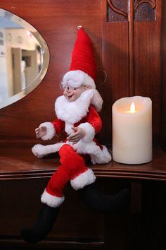 Good ol' Frank! Can you tell Frank's Santas biggest fan? He's dressed up like his idol all year long! We caught him sitting on this mantle piece thinking about how awesomely close the holiday season is. Such an excited little guy!