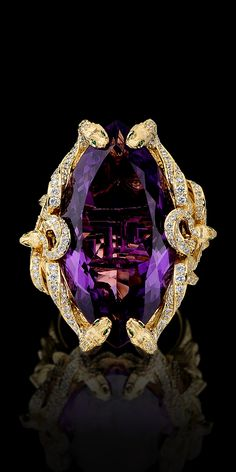 """Master Exclusive """"Mysticism"""" 18k yellow & white gold with white & green diamonds. I love Amethyst.Medusa is on the profile of this ring. Medusa for protection."""