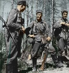 reparations: Lauri Törni among some of his rangers in the Finnish Army. Törni also served in the Waffen-SS at the rank of Untersturmführer and after the war ended up serving as a US Special Forces officer in Vietnam and Laos.