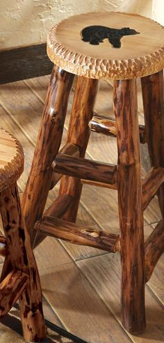 Carved Wood Bar Stool: A black bear is hand-carved and hand-painted in exquisite detail on the seat of the pine log Carved Wood Bear Large Barstool with a clear-coat catalyzed lacquer finish.