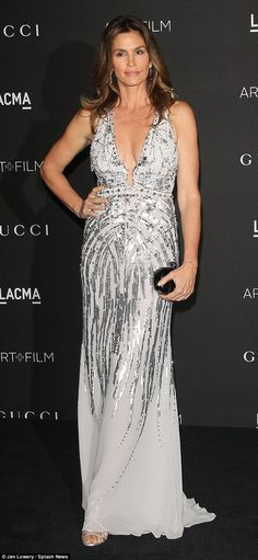 Timeless beauty: Cindy Crawford looked far younger than her 48 years in her silver embellished gown at the LACMA Art + Film Gala http://dailym.ai/1DMjl91