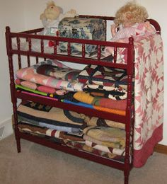 how I wish I still had all my family quilts, tablecloths and fabrics (along w/ everything else) which were deliberately stolen from me in the most devious and calculating way. I love this as display/storage - repurposed changing table