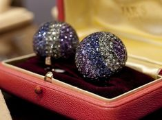 "Elizabeth Taylor's diamond and multi-colored sapphire ""Ball"" ear clips, from JARS, estimated ..."