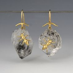 "A pair of18k yellow gold earrings with herkimer crystals and 18k yellow gold ants. Total length measures 1 1/4""."