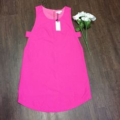 NWT Fuschia loveriche Shift Dress Brand new shift dress with cutouts. True to size. Selling for a friend so I cannot model . From shoulder to bottom is 35 inches. Bust is 18 inches. Same day or next day shipping. Open to offers!  Loveriche Dresses Mini