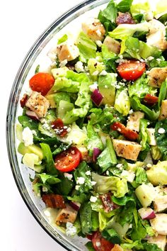 Chicken, bacon and avocado come together in this delicious chopped salad, topped with a garlicky vinaigrette. What could be better?