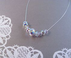 Multifaceted Swarovski crystals - Sterling Silver, with extender chain - 15.5-inch (38.5 cm) chain, plus 2-inch (5 cm) extender Nine multifaceted Swarovski crystal beads in complementary sizes form a clear, translucent crescent. This necklace is an amazing mix of subtle and striking --