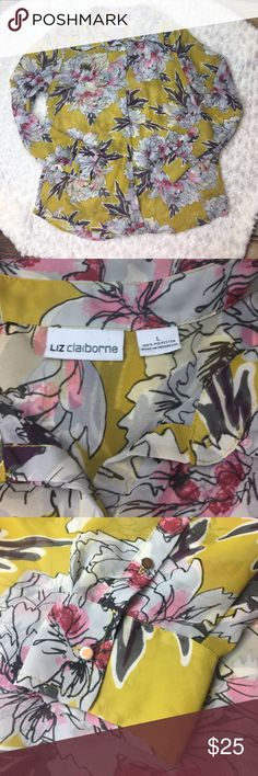 "Liz Claiborne Floral Button Down Beautiful Floral Button Down by Liz Claiborne. Two Buttons on each Sleeve. Button front with cover over buttons. One button is chipped (see picture) but with the button cover you would never know. Bust 44"", Length 27"", Sleeve Length 25"". 100% Polyester. Liz Claiborne Tops Button Down Shirts"