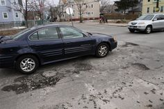 #ripotholes At the corner of Regent Ave. and River Ave. in Providence. Journal photo / Bob Breidenbach