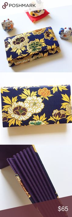 Vintage Japanese Silk Purse BEAUTIFUL embroidered silk (kimono style) clutch from Japan. Vintage but never been used and in immaculate condition. M. Yamamoto & Co. Kyoto, Japan. Best guess is circa 1950s. Very dark blue base/purple sides & interior. Simple snap closure. 8.5x5x1. Comes with box. Please feel free to ask any questions prior to purchase. Vintage Bags Clutches & Wristlets