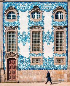 Intricate blue & white facade in Porto, Portugal~Image via afarmedia