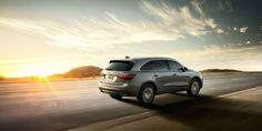 2015 Acura MDX gray rear to side view exterior driving sunset