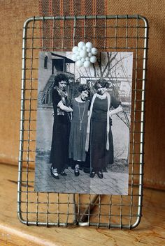 Super Easy Photo Display Stand: Old wire strainer & clip-on earring / Mamie Jane's