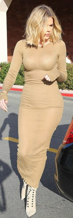 Who made  Khloe Kardashian's green lace up boots, gold jewelry, and beige ribbed sleeve maxi dress?