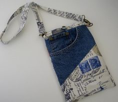 OOAK Recycled denim E Book or ipad pouch with detachable strap. Extra large front pocket for extra items and charger.