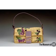 Brand: Fendi  Italian, founded 1925    Medium: Metallic silk brocade, multicolor chenille, lavender snakeskin and gold metal  Date: Fall 2001  Country: Italy  Credit: Gift of Fendi  Fendi is known for luxurious furs and innovative accessories. Since fall 1997, the whimsically named Baguette handbag has been one of the company's most successful designs. Rendered in nearly six hundred different materials and crafted of the highest quality materials, the bags became collectors' items.
