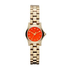 This luxurious Marc By Marc Jacobs watch is designed with a goldtone steel case and bracelet. An orange dial completes the look of this desirable watch.