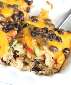 Cheesy Veggie and Black Bean Tortilla Casserole ~ An Easy and Satisfying Meatless Meal {MomFoodie at blommi.com} - this has possibilities - use corn tortilla strips that have been baked? Add tomatoes?
