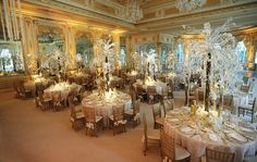 Grace Ormonde Wedding Style Platinum Member   White and gold linen with a sequined tulle overlay showcasing a crystal tree adorned with white phalaenopsis orchids. Location, Flatware and Chairs: Mar-a-lago Club, Palm Beach, FL; Table and Floral Design: Xquisite Events, Inc., Boca Raton, FL; Linen: Ruth Fischl, New York, NY; Chair Covers: Nüage Designs, Miami, FL; China: Panache, A Classic Party Rentals Company, Pompano Beach, FL; Photography: Ray Santana Photography, Miami, FL