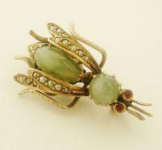 Beautiful Edwardian cats eye and split pearl bug brooch