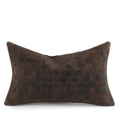 Like a perfectly worn-in saddle bag, our distressed brown woven leather pillows rugged good looks only improve with age. Handmade by artisans who weave strips of leather in a basket weave pattern for the front, then back with matching linen or leather.   Free Shipping!