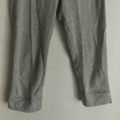 Grey Crop Leggings Grey cotton leggings with sparkles at bottom.  Good fit. Stretch. Size: YL. Or Adult small. Worn but in good condition. target Pants Leggings