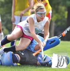 Goalie Niki Bream and Julia Snyder, top, get tangled up during practice Monday. Dallastown High School girls field hockey and soccer practice began Monday, August 13, 2012.    Bil Bowden photos