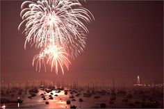 The boats lit up by fireworks in Marblehead