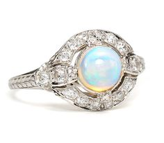 Art Deco Opal Platinum Ring, set in platinum with 18 transitional and single cut diamonds with a total estimated weight of carats. I Love Jewelry, Art Deco Jewelry, Opal Jewelry, Jewelry Rings, Jewelry Design, Antique Jewelry, Vintage Jewelry, Diamond Gemstone, Emerald Diamond