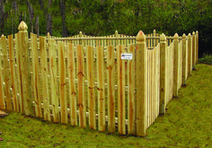 Simple picket fence with gothic posts. Designed and built by Atlanta Decking & Fence.  http://atlantadecking.com/