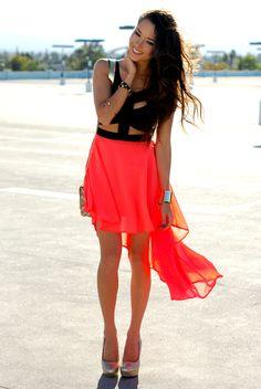 Neon orange cut out dress.