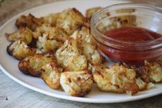 Baked Cauliflower Poppers (39 calories)--a healthy & delicious party food! I will try this without salt!