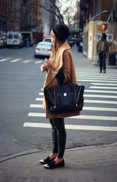 We Wore What. Camel coat, Black and gold flats. Black beanie.