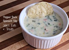 Pepper Jack Spinach Dip ~ Loaded with Queso, Pepper Jack, Red Peppers, Jalapenos and Spinach! via www.julieseatsandtreats.com