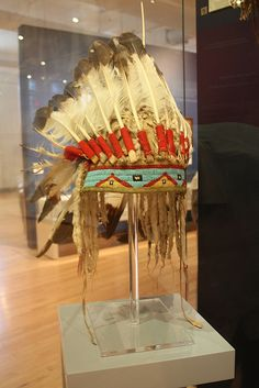 Sitting Bull's headdress. Headresses like these aren't meant for style. They are sacred. Only those chosen by the nation wear these. They aren't meant for Etsy or for Festival  attire.