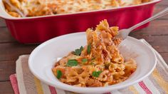 Cheesy Chicken Pasta Bake.. For an even cheesier taste, use classico four cheese sauce, heat and stir in with 4 oz of cream cheese. Add some of the mixture to the tomatoes. Yum!