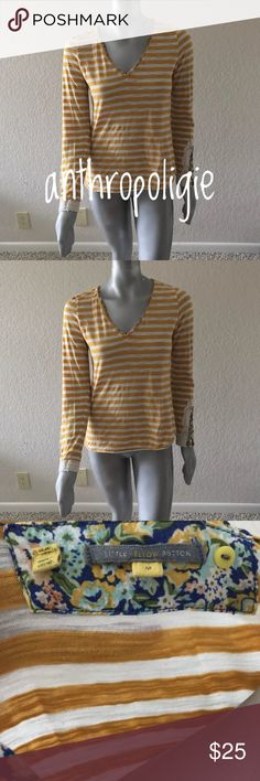 """Anthropologie Little Yellow Button Woman T-Shirt Anthropologie Little Yellow Button Woman T-Shirt Cotton Relax V Neck Striped Embroidered Cuff Sz M  Type: Woman T Shirt  Style: Woman Relax V Neck T Shirt  Brand: Anthropologie Little Yellow Button  Material: Cotton, Polyester  Color: Yellow, White  Measurements Armpit to Armpit: 17"""",'Length: 23""""  Condition: Pre-owned. Please check the condition of the item on the pictures for more details. Pet and smoke free. Anthropologie Tops Tees - Long…"""