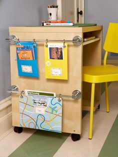 Attach towel racks to the side of a desk to create a file cabinet. Add grommets to file folders and hang them from the bars with curtain hooks. Personalize each folder with labels and postcards for a memorable way to organize.